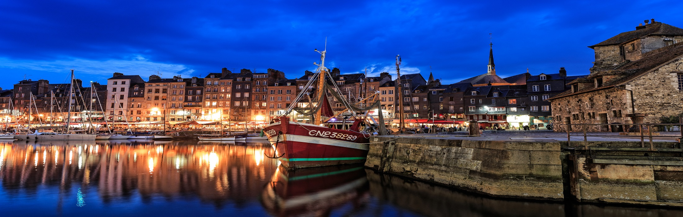 Honfleur, a port town  Fishing Port The outer harbour is reserved to fishing boats which come to moor at the quayside and unload their day's 1